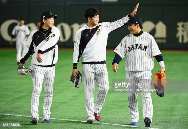 Pitcher Naoki Miyanishi Pitcher Tomoyuki Sugano and Pitcher Takahiro Norimoto of Japan are seen prior to the World Baseball Classic Pool E Game Six...