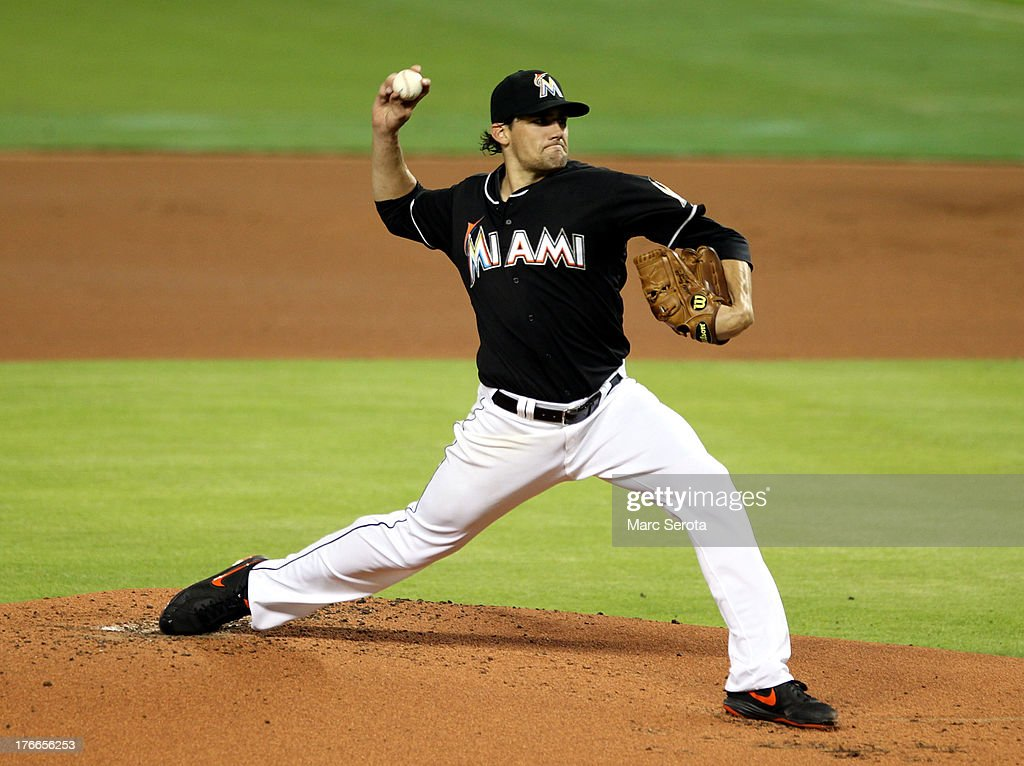 Pitcher <a gi-track='captionPersonalityLinkClicked' href=/galleries/search?phrase=Nathan+Eovaldi&family=editorial&specificpeople=8023089 ng-click='$event.stopPropagation()'>Nathan Eovaldi</a> #24 of the Miami Marlins throws against the San Francisco Giants at Marlins Park on August 16, 2013 in Miami, Florida.
