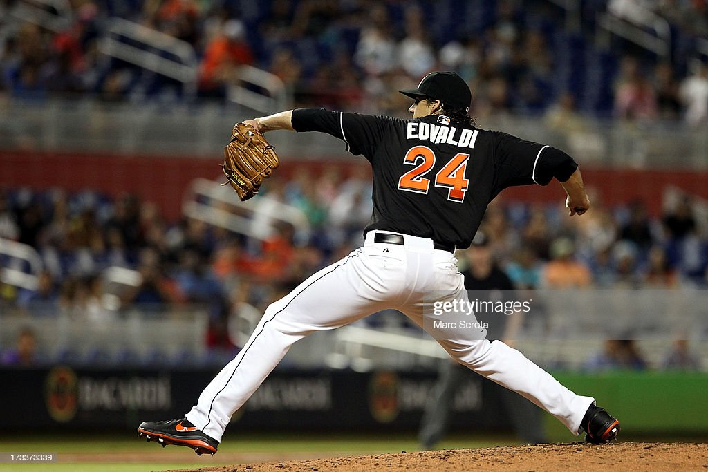 Pitcher <a gi-track='captionPersonalityLinkClicked' href=/galleries/search?phrase=Nathan+Eovaldi&family=editorial&specificpeople=8023089 ng-click='$event.stopPropagation()'>Nathan Eovaldi</a> #24 of the Miami Marlins throws against the Washington Nationals during the second inning at Marlins Park on July 12, 2013 in Miami, Florida.