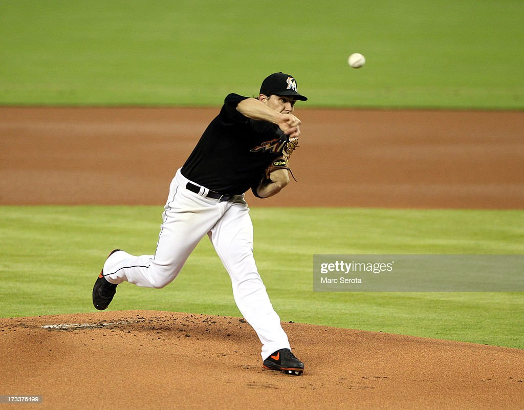 Pitcher <a gi-track='captionPersonalityLinkClicked' href=/galleries/search?phrase=Nathan+Eovaldi&family=editorial&specificpeople=8023089 ng-click='$event.stopPropagation()'>Nathan Eovaldi</a> #24 of the Miami Marlins throws against the Washington Nationals during the first inning at Marlins Park on July 12, 2013 in Miami, Florida.The Marlins defeated the Nationals 8-3.