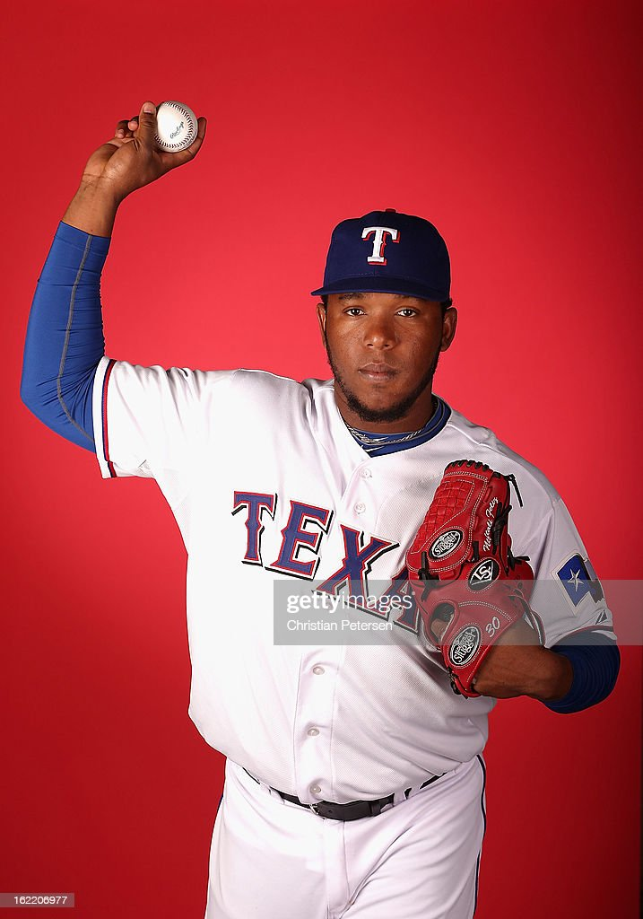 Pitcher <a gi-track='captionPersonalityLinkClicked' href=/galleries/search?phrase=Neftali+Feliz&family=editorial&specificpeople=5753005 ng-click='$event.stopPropagation()'>Neftali Feliz</a> #30 of the Texas Rangers poses for a portrait during spring training photo day at Surprise Stadium on February 20, 2013 in Surprise, Arizona.