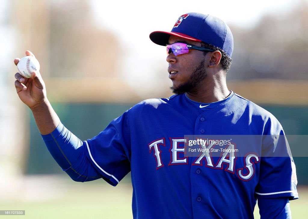 Pitcher Neftali Feliz of the Texas Rangers runs through drills during spring training in Surprise, Arizona, on Thursday, February 14, 2013.