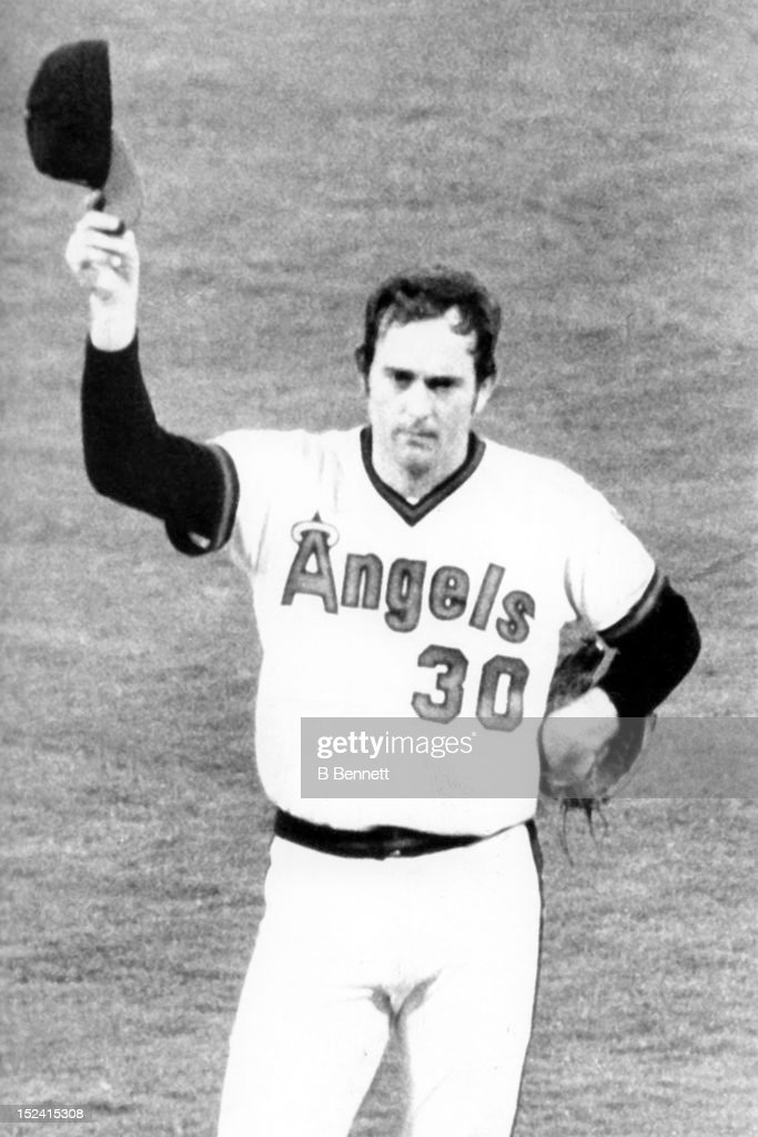 Pitcher <a gi-track='captionPersonalityLinkClicked' href=/galleries/search?phrase=Nolan+Ryan&family=editorial&specificpeople=202212 ng-click='$event.stopPropagation()'>Nolan Ryan</a> #30 of the California Angels tips his cap to the crowd after Reggie Jackson #44 of the New York Yankees (not pictured) broke up his no-hitter in the ninth inning during their game on July 13, 1979 at Angel Stadium in Anaheim, California.