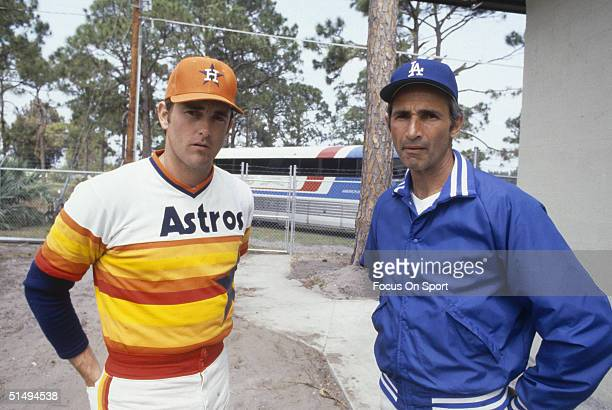 Pitcher Nolan Ryan of the Houston Astros poses for the camera with Hall of Famer Sandy Koufax during spring training during the 1980s