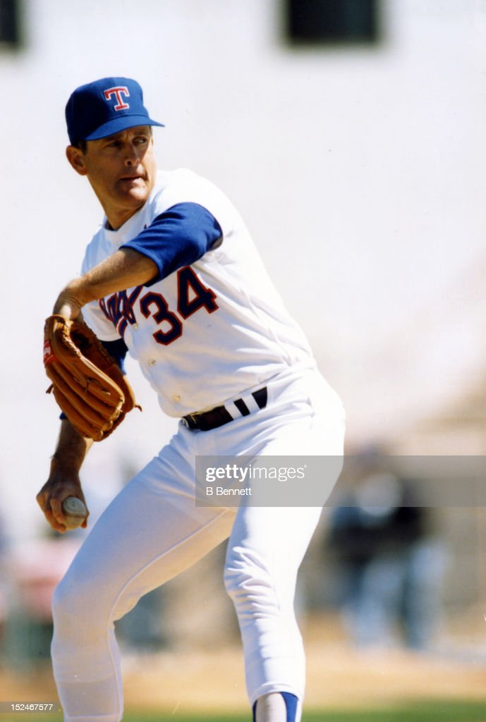 Pitcher <a gi-track='captionPersonalityLinkClicked' href=/galleries/search?phrase=Nolan+Ryan&family=editorial&specificpeople=202212 ng-click='$event.stopPropagation()'>Nolan Ryan</a> #34 of the Texas Rangers pitches during an MLB spring training game in March, 1992 at Pompano Beach Municipal Stadium in Pompano Beach, Florida.