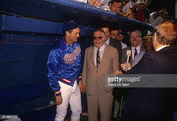 Pitcher Nolan Ryan of the Texas Rangers talks with baseball commisioner A Bartlett Giamatti after striking out Oakland Athletics Rickey Henderson in...