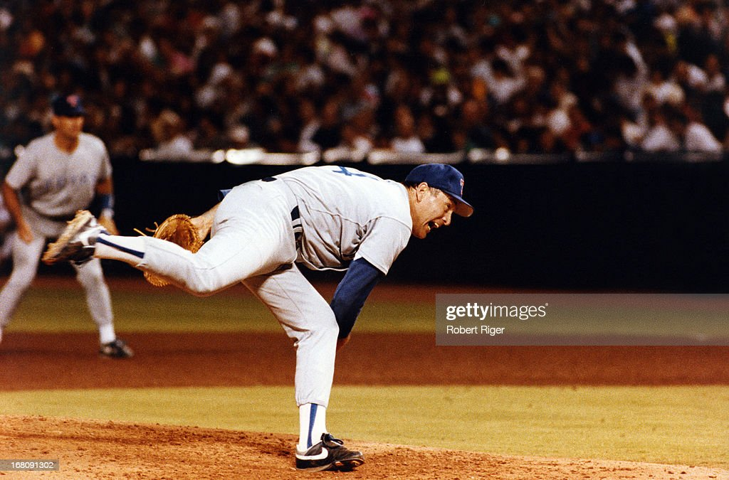 Pitcher <a gi-track='captionPersonalityLinkClicked' href=/galleries/search?phrase=Nolan+Ryan&family=editorial&specificpeople=202212 ng-click='$event.stopPropagation()'>Nolan Ryan</a> #34 of the Texas Rangers throws a pitch during an MLB game circa 1992 at Arlington Stadium in Arlington, Texas.