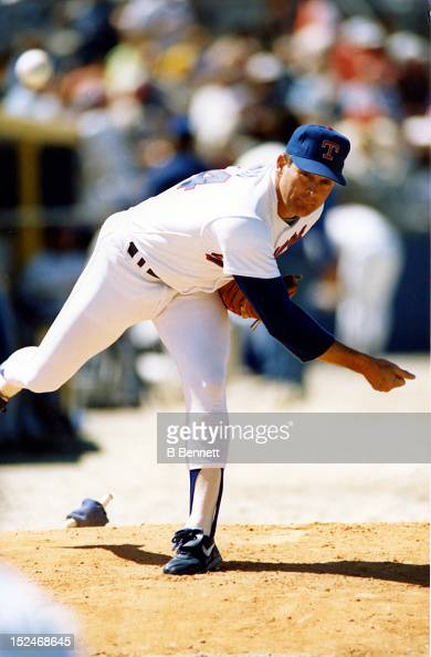 Pitcher Nolan Ryan of the Texas Rangers warms up in the bullpen before an MLB spring training game in March 1991 at Pompano Beach Municipal Stadium...