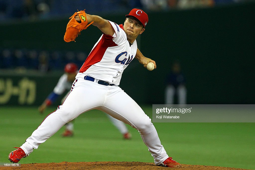 Pitcher <a gi-track='captionPersonalityLinkClicked' href=/galleries/search?phrase=Norberto+Gonzalez&family=editorial&specificpeople=797703 ng-click='$event.stopPropagation()'>Norberto Gonzalez</a>#33 of Cuba pitches during the World Baseball Classic Second Round Pool 1 game between Chinese Taipei and Cuba at Tokyo Dome on March 9, 2013 in Tokyo, Japan.