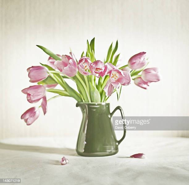 Pitcher of flowers on table