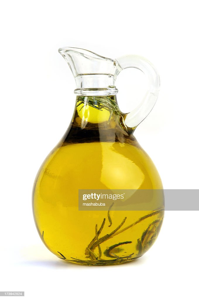 Pitcher of olive oil with rosemary
