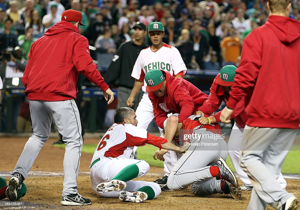 Pitcher Oliver Perez #46 and coaches of Mexico attempt to subdue Scott Mathieson #47 of Canada during an on field altercation between both teams in the World Baseball Classic First Round Group D game at Chase Field on March 9, 2013 in Phoenix, Arizona.