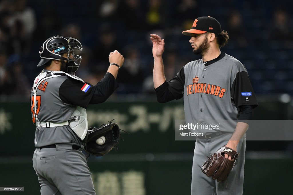 Pitcher Orlando Yntema (R) #40 and Catcher Shawn Zarraga (L) #37 of the Netherlands celebrate their 12-2 victory after the World Baseball Classic Pool E Game Three between Netherlands and Israel at the Tokyo Dome on March 13, 2017 in Tokyo, Japan.