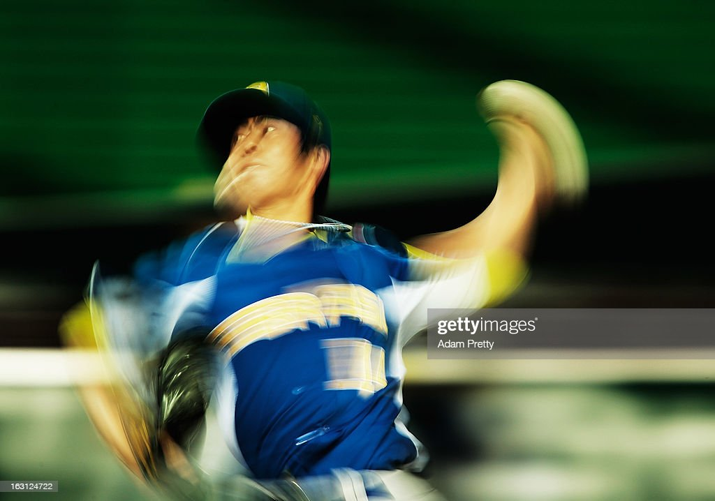 Pitcher Oscar Nakaoshi #14 of Brazil pitches during the World Baseball Classic First Round Group A game between China and Brazil at Fukuoka Yahoo! Japan Dome on March 5, 2013 in Fukuoka, Japan.