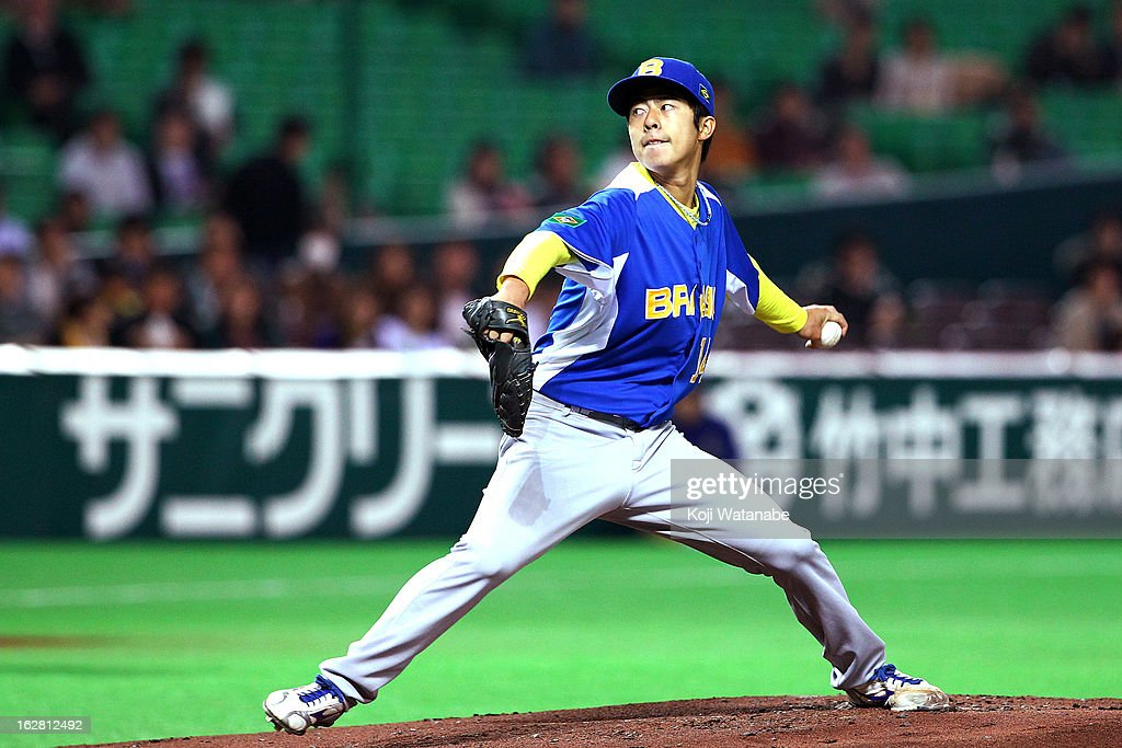 Pitcher Oscar Nakaoshi #14 of Brazil Starting pitcher against Fukuoka SoftBank Hawks in the bottom half of the first inning during the friendly game between Fukuoka Softbank Hawks and Brazil at Fukuoka Yafuoku! Dome on February 28, 2013 in Fukuoka, Japan.