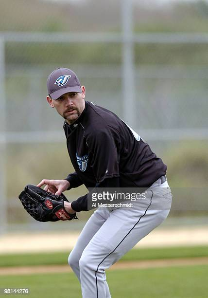 Pitcher Pat Hentgen fields a ball during spring training drills at the Toronto Blue Jays camp in Dunedin Florida February 27 2004