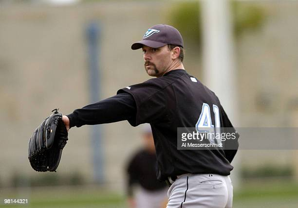 Pitcher Pat Hentgen tosses a ball during spring training drills at the Toronto Blue Jays camp in Dunedin Florida February 27 2004