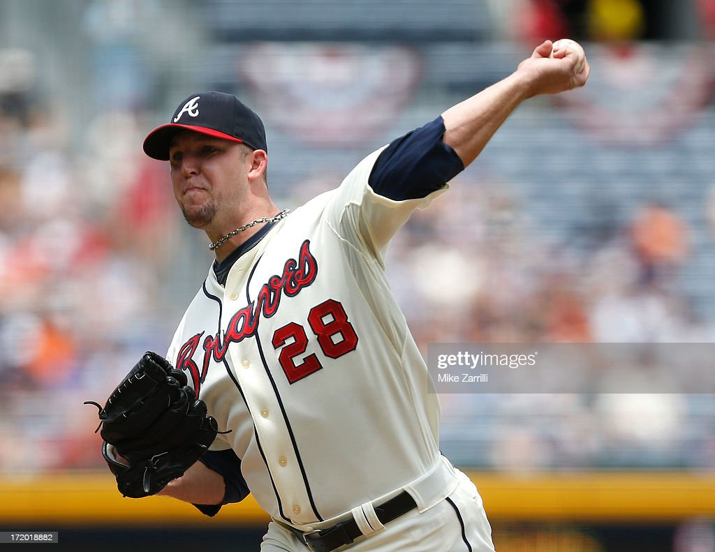 Pitcher <a gi-track='captionPersonalityLinkClicked' href=/galleries/search?phrase=Paul+Maholm&family=editorial&specificpeople=585406 ng-click='$event.stopPropagation()'>Paul Maholm</a> #28 of the Atlanta Braves throws a pitch during the game against the Arizona Diamondbacks at Turner Field on June 30, 2013 in Atlanta, Georgia.