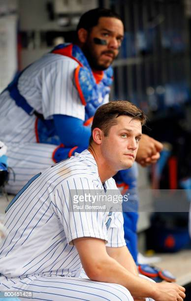 Pitcher Paul Sewald and catcher Rene Rivera of the New York Mets sit in the dugout reacting after the 8th inning in an MLB baseball game against the...
