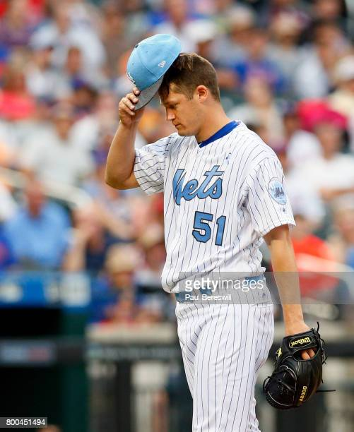 Pitcher Paul Sewald of the New York Mets reacts in an MLB baseball game against the Washington Nationals on June 17 2017 at CitiField in the Queens...