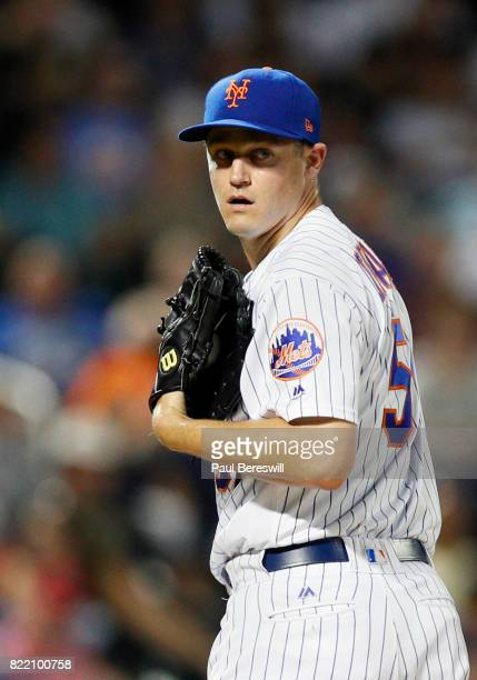 Pitcher Paul Sewald of the New York Mets throws to first base in an interleague MLB baseball game against the Oakland Athletics on July 21 2017 at...