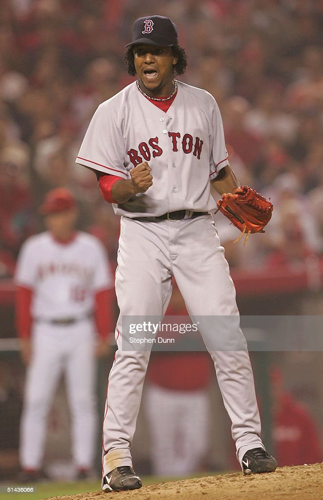 Pitcher Pedro Martinez of the Boston Red Sox celebrates after striking out Chone Figgins of the Anaheim Angels to end the seventh inning of the...