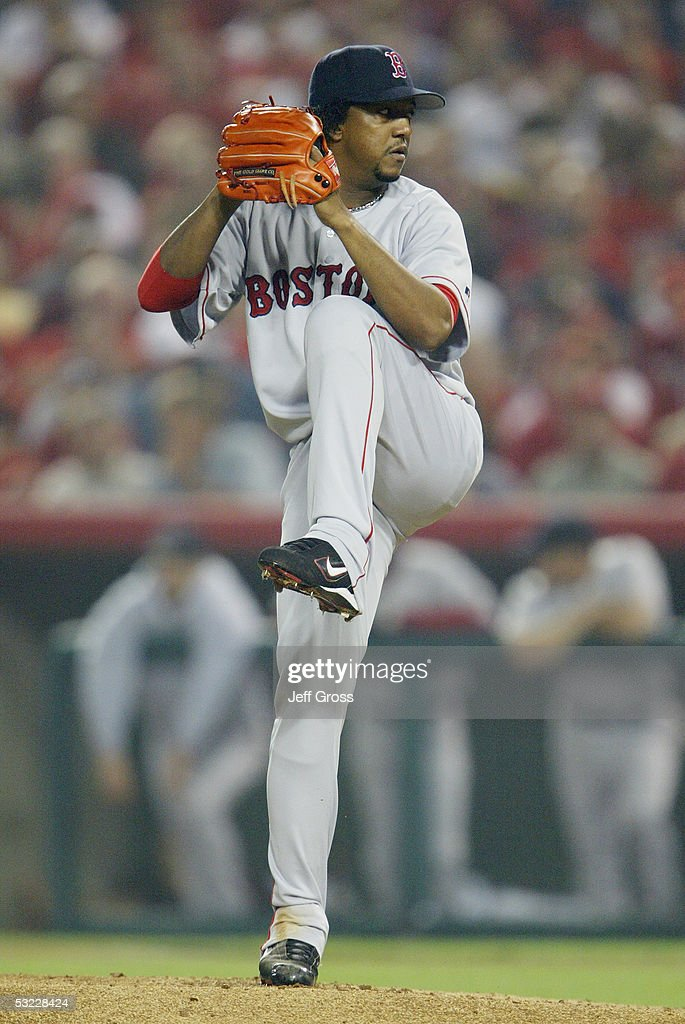Pitcher <a gi-track='captionPersonalityLinkClicked' href=/galleries/search?phrase=Pedro+Martinez&family=editorial&specificpeople=171773 ng-click='$event.stopPropagation()'>Pedro Martinez</a> #45 of the Boston Red Sox delivers a pitch during the American League Division Series with the Anaheim Angels, Game Two on October 6, 2004 at Angels Stadium at Anaheim in Anaheim, California.