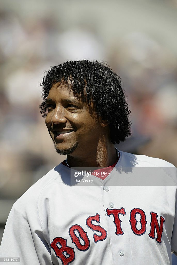 Pitcher <a gi-track='captionPersonalityLinkClicked' href=/galleries/search?phrase=Pedro+Martinez&family=editorial&specificpeople=171773 ng-click='$event.stopPropagation()'>Pedro Martinez</a> #45 of the Boston Red Sox smiles during the game against the Chicago White Sox at U.S. Cellular Field on August 21, 2004 in Chicago, Illinois. The White Sox were defeated by the Red Sox 10-7.
