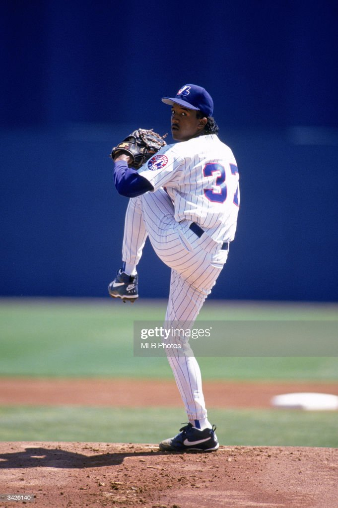 Pitcher <a gi-track='captionPersonalityLinkClicked' href=/galleries/search?phrase=Pedro+Martinez&family=editorial&specificpeople=171773 ng-click='$event.stopPropagation()'>Pedro Martinez</a> #37 of the Montreal Expos pitches during a 1994 Spring Training game.