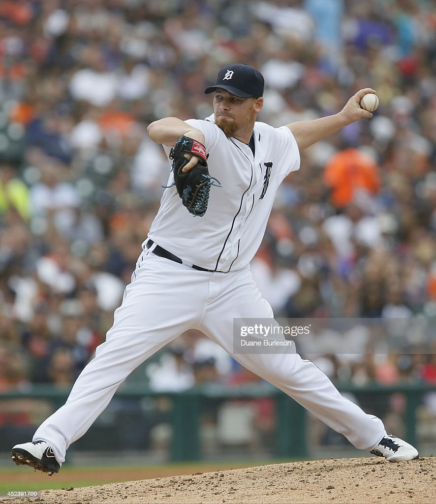 Pitcher <a gi-track='captionPersonalityLinkClicked' href=/galleries/search?phrase=Phil+Coke&family=editorial&specificpeople=5518031 ng-click='$event.stopPropagation()'>Phil Coke</a> #40 of the Detroit Tigers delivers against the Cleveland Indians during the eighth inning of game one of a doubleheader at Comerica Park on July 19, 2014 in Detroit, Michigan. The Indians defeated the Tigers 6-2.