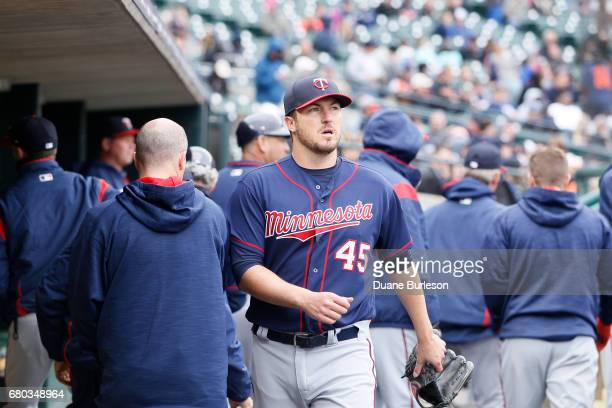 Pitcher Phil Hughes of the Minnesota Twins walks through the dugout after being pulled from a game against the Detroit Tigers at Comerica Park on...