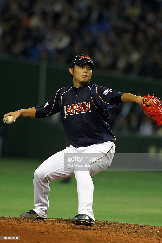 Pitcher Pitcher <a gi-track='captionPersonalityLinkClicked' href=/galleries/search?phrase=Tadashi+Settsu&family=editorial&specificpeople=4629361 ng-click='$event.stopPropagation()'>Tadashi Settsu</a> #50 of Japan pitches during the World Baseball Classic Second Round Pool 1 game between Japan and Chinese Taipei at Tokyo Dome on March 8, 2013 in Tokyo, Japan.