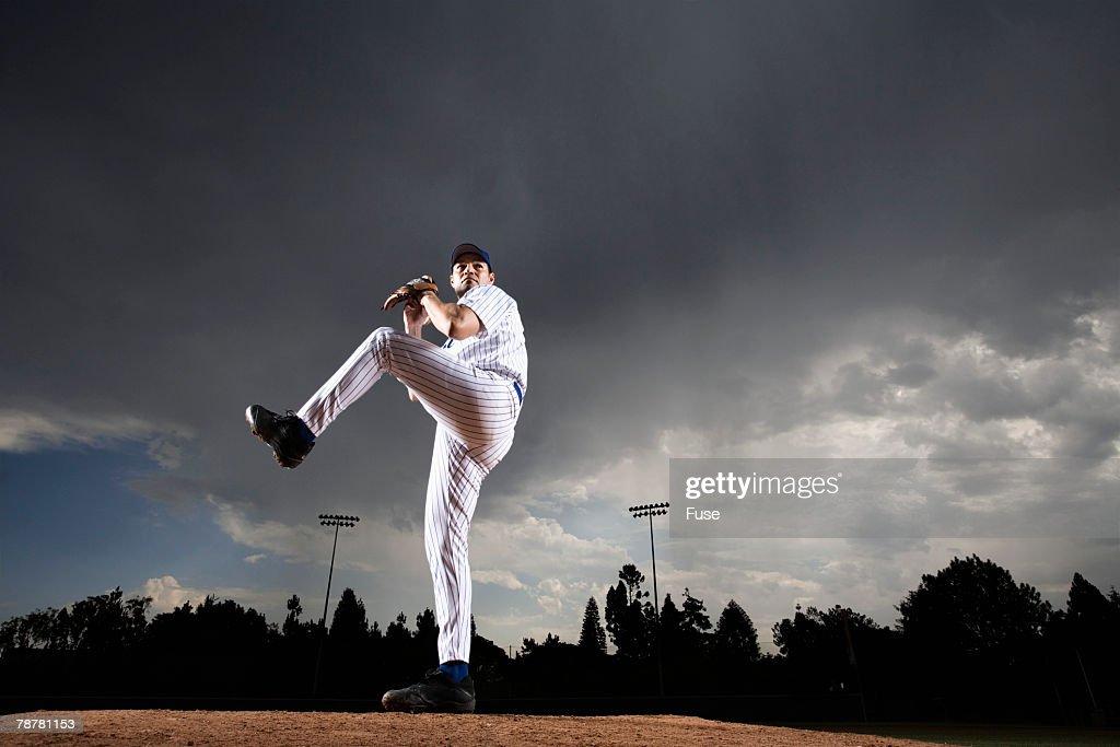 Pitcher Preparing to Pitch Ball
