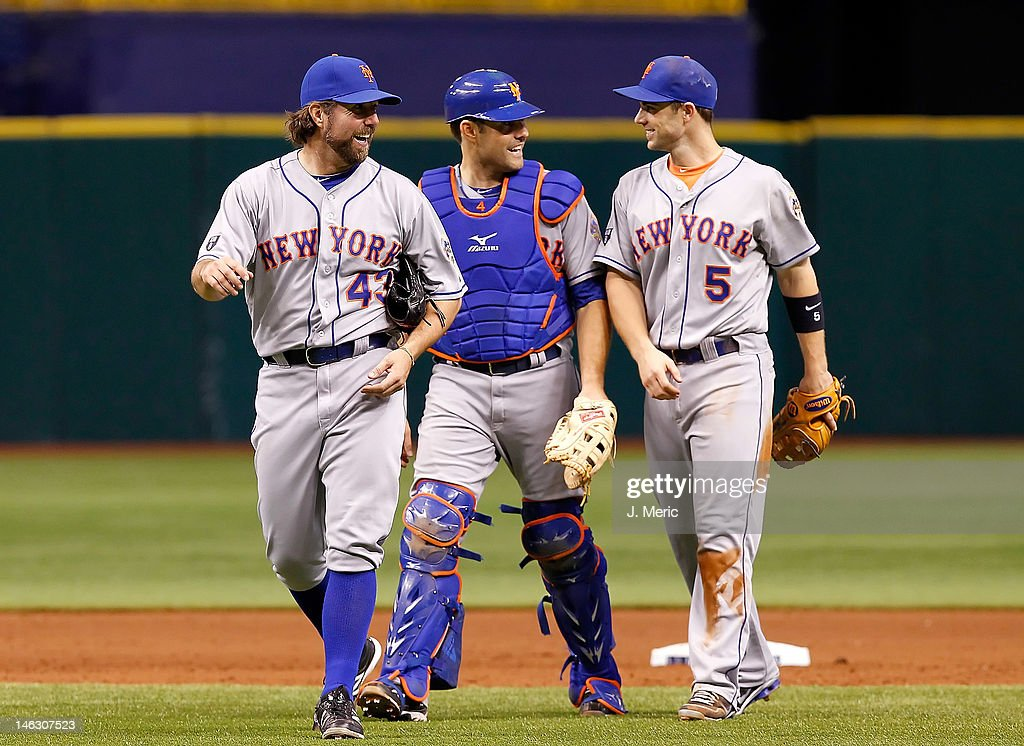 Pitcher <a gi-track='captionPersonalityLinkClicked' href=/galleries/search?phrase=R.A.+Dickey&family=editorial&specificpeople=221719 ng-click='$event.stopPropagation()'>R.A. Dickey</a> #43, catcher Mike Nickeas #4 and infielder <a gi-track='captionPersonalityLinkClicked' href=/galleries/search?phrase=David+Wright+-+Baseball+Player&family=editorial&specificpeople=209172 ng-click='$event.stopPropagation()'>David Wright</a> #5 of the New York Mets celebrate victory over the Tampa Bay Rays at Tropicana Field on June 13, 2012 in St. Petersburg, Florida.