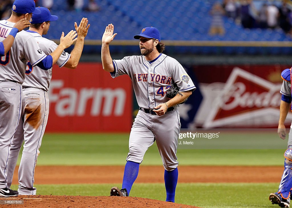 Pitcher <a gi-track='captionPersonalityLinkClicked' href=/galleries/search?phrase=R.A.+Dickey&family=editorial&specificpeople=221719 ng-click='$event.stopPropagation()'>R.A. Dickey</a> #43 of the New York Mets is congratulated after his one hit complete game against the Tampa Bay Rays at Tropicana Field on June 13, 2012 in St. Petersburg, Florida.