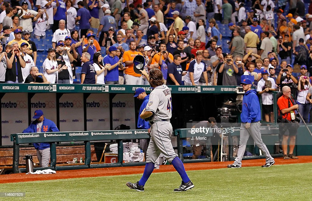 Pitcher <a gi-track='captionPersonalityLinkClicked' href=/galleries/search?phrase=R.A.+Dickey&family=editorial&specificpeople=221719 ng-click='$event.stopPropagation()'>R.A. Dickey</a> #43 of the New York Mets tips his hat to the crowd after his one hit complete game against the Tampa Bay Rays at Tropicana Field on June 13, 2012 in St. Petersburg, Florida.
