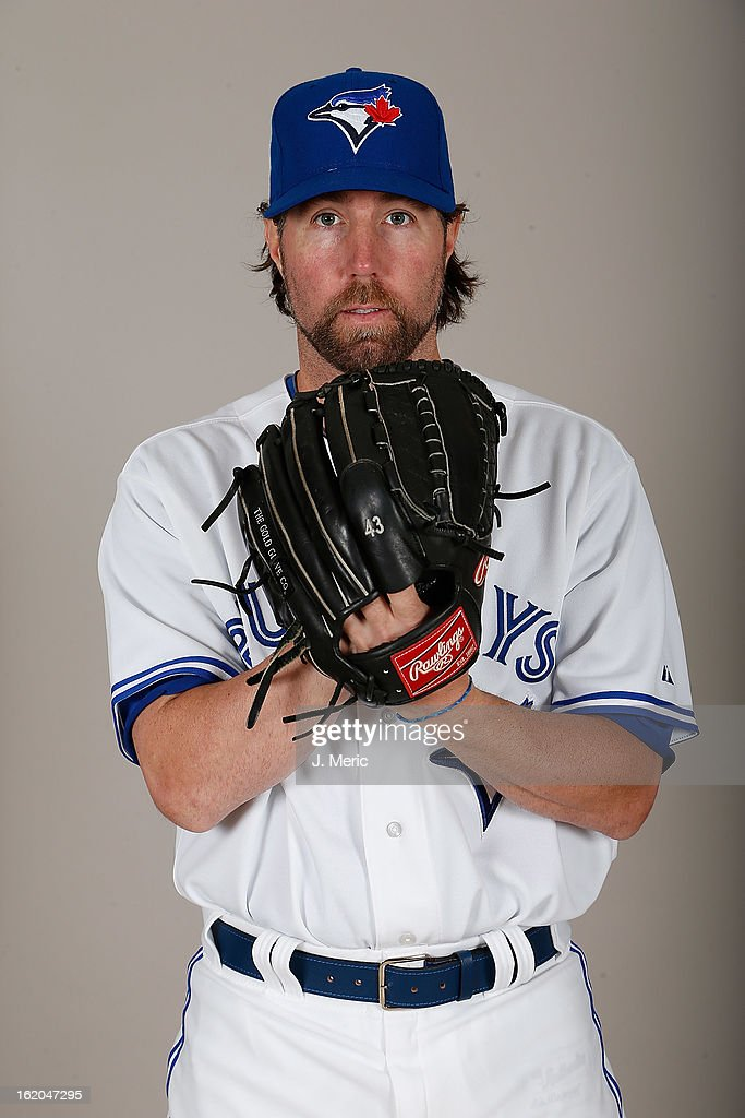 Pitcher <a gi-track='captionPersonalityLinkClicked' href=/galleries/search?phrase=R.A.+Dickey&family=editorial&specificpeople=221719 ng-click='$event.stopPropagation()'>R.A. Dickey</a> #43 of the Toronto Blue Jays poses for a photo during photo day at Florida Auto Exchange Stadium on February 18, 2013 in Dunedin, Florida.