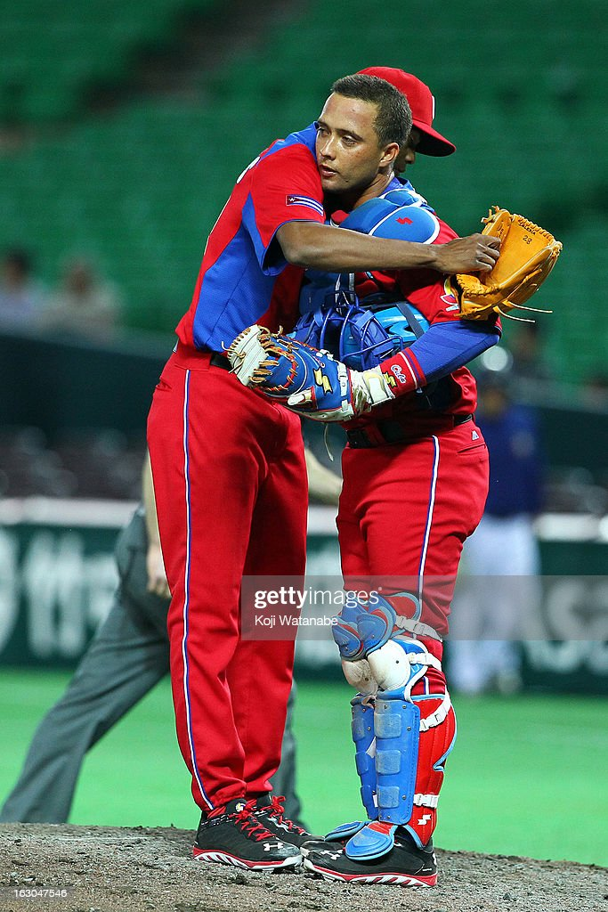 Pitcher Raciel Iglesias #28 and Catcher Frank Morejon #45 (R) of Cuba celebrate winning the World Baseball Classic First Round Group A game between Brazil and Cuba at Fukuoka Yahoo! Japan Dome on March 3, 2013 in Fukuoka, Japan.