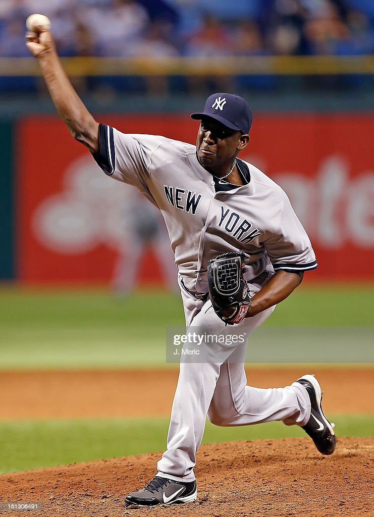 Pitcher <a gi-track='captionPersonalityLinkClicked' href=/galleries/search?phrase=Rafael+Soriano&family=editorial&specificpeople=587892 ng-click='$event.stopPropagation()'>Rafael Soriano</a> #29 of the New York Yankees pitches against the Tampa Bay Rays during the game at Tropicana Field on September 5, 2012 in St. Petersburg, Florida.
