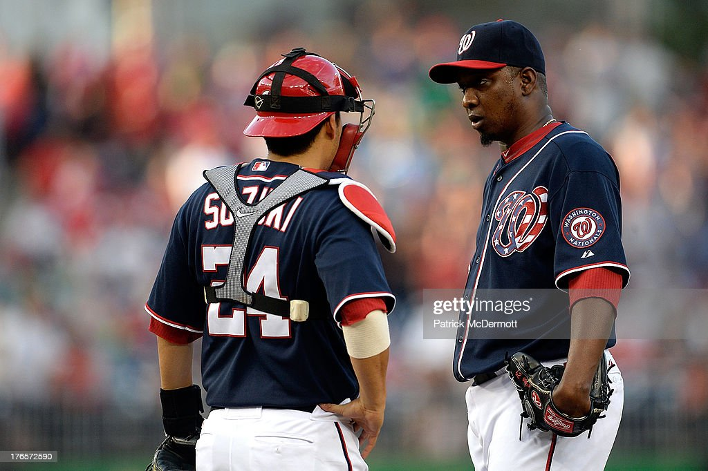 Pitcher <a gi-track='captionPersonalityLinkClicked' href=/galleries/search?phrase=Rafael+Soriano&family=editorial&specificpeople=587892 ng-click='$event.stopPropagation()'>Rafael Soriano</a> #29 of the Washington Nationals talks with catcher <a gi-track='captionPersonalityLinkClicked' href=/galleries/search?phrase=Kurt+Suzuki&family=editorial&specificpeople=682702 ng-click='$event.stopPropagation()'>Kurt Suzuki</a> #24 during the ninth inning of a game against the San Francisco Giants at Nationals Park on August 15, 2013 in Washington, DC.