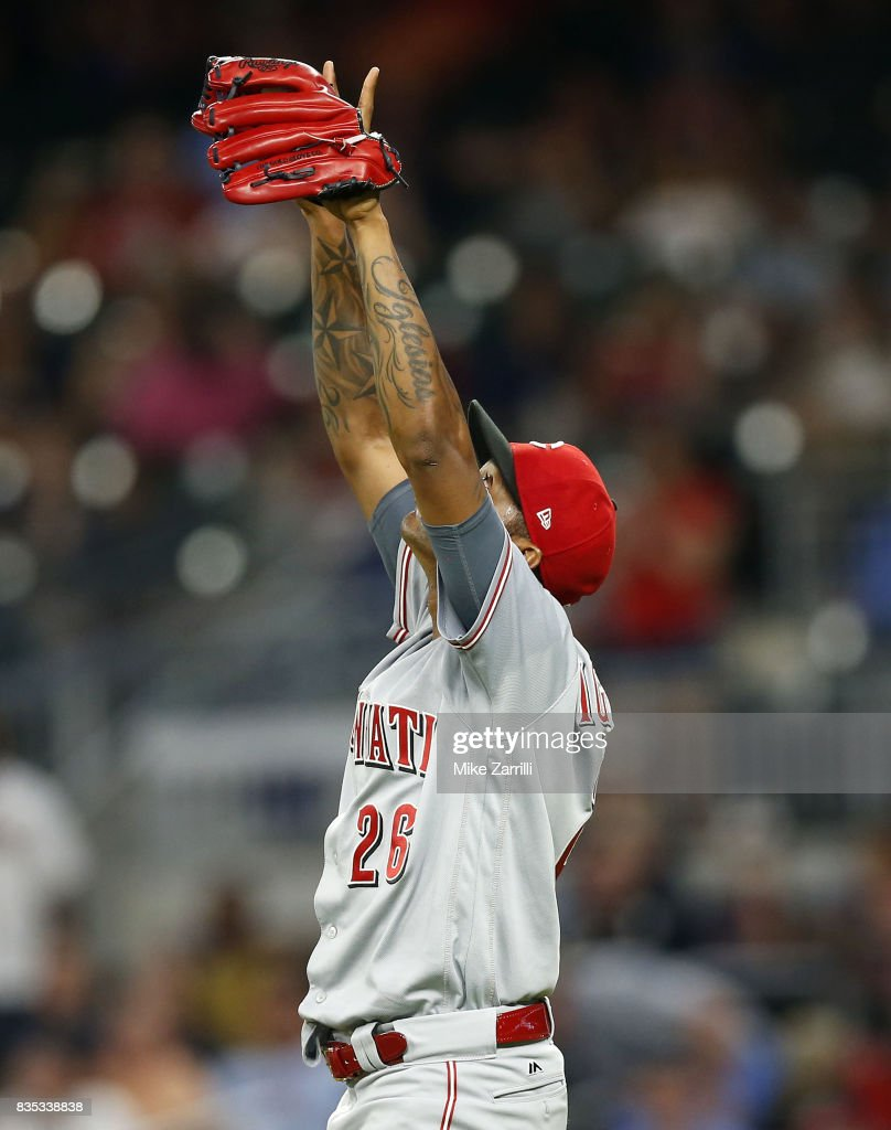 Pitcher Raisel Iglesias #26 of the Cincinnati Reds celebrates after the game against the Atlanta Braves at SunTrust Park on August 18, 2017 in Atlanta, Georgia.
