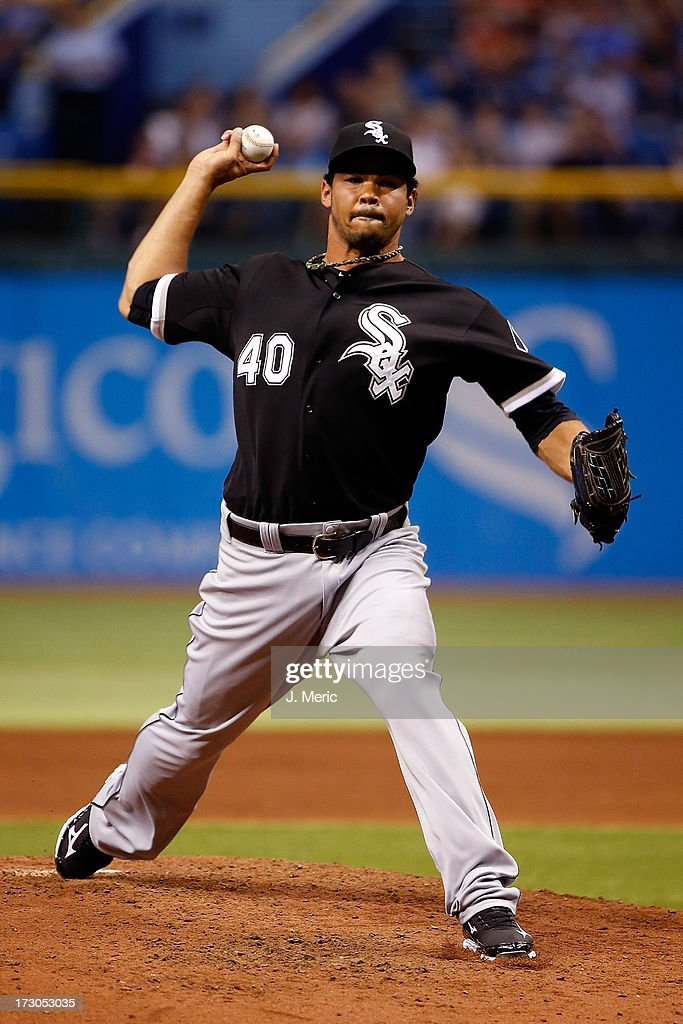 Pitcher <a gi-track='captionPersonalityLinkClicked' href=/galleries/search?phrase=Ramon+Troncoso&family=editorial&specificpeople=4956899 ng-click='$event.stopPropagation()'>Ramon Troncoso</a> #40 of the Chicago White Sox replaces starter Dylan Axelrod #33 in the second inning against the Tampa Bay Rays at Tropicana Field on July 5, 2013 in St. Petersburg, Florida.