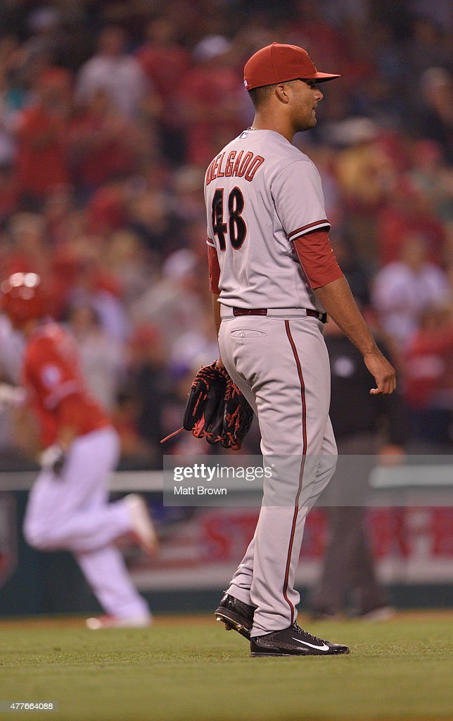 Pitcher Randall Delgado #48 of the Arizona Diamondbacks reacts after allowing a two-run home run to <a gi-track='captionPersonalityLinkClicked' href=/galleries/search?phrase=David+Freese+-+Baseball+Player&family=editorial&specificpeople=4948315 ng-click='$event.stopPropagation()'>David Freese</a> of the Los Angeles Angels of Anaheim during the eighth inning of the game at Angel Stadium of Anaheim on June 16, 2015 in Anaheim, California.
