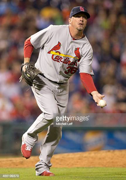 Pitcher Randy Choate of the St Louis Cardinals flips the ball to first base against the Philadelphia Phillies on August 23 2014 at Citizens Bank Park...