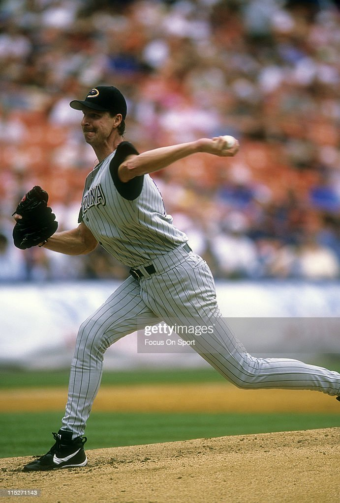 Pitcher Randy Johnson #51 of the Arizona Diamondbacks pitches against the New York Mets during a Major League Baseball game circa 2002 at Shea Stadium in the Queens borough of New York City. Johnson played for the Diamondbacks from 1999-04 and 2007-08.