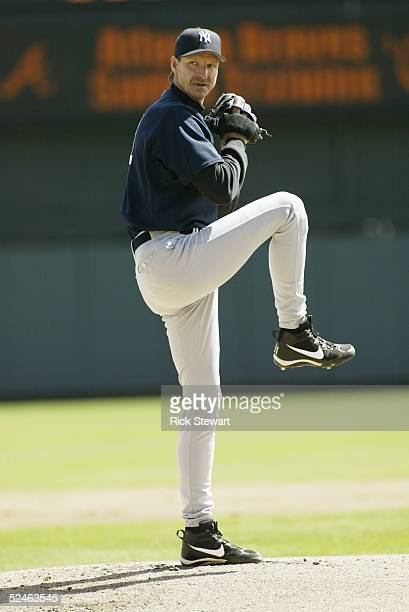 Pitcher Randy Johnson of the New York Yankees delivers against the Atlanta Braves during a Spring Training game on March 8 2005 at Cracker Jack...