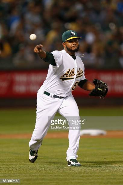 Pitcher Raul Alcantara of the Oakland Athletics fields a ball hit by Elvis Andrus of the Texas Rangers in the fourth inning at Oakland Alameda...