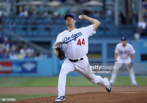 PItcher Rich Hill of the Los Angeles Dodgers pitches in the first inning during the MLB game against the Cincinnati Reds at Dodger Stadium on June 9...