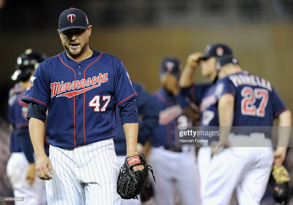 PItcher <a gi-track='captionPersonalityLinkClicked' href=/galleries/search?phrase=Ricky+Nolasco&family=editorial&specificpeople=600111 ng-click='$event.stopPropagation()'>Ricky Nolasco</a> #47 of the Minnesota Twins reacts as he leaves the game against the Arizona Diamondbacks during the fifth inning on September 22, 2014 at Target Field in Minneapolis, Minnesota. The Diamondbacks defeated the Twins 6-2.