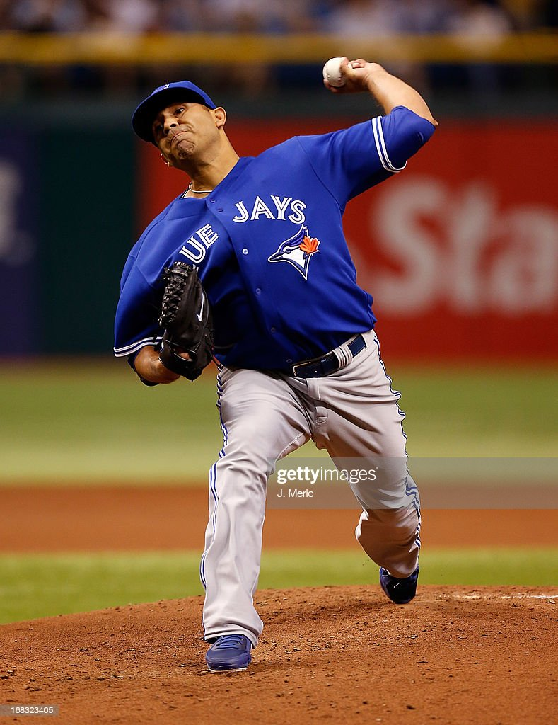 Pitcher <a gi-track='captionPersonalityLinkClicked' href=/galleries/search?phrase=Ricky+Romero&family=editorial&specificpeople=809221 ng-click='$event.stopPropagation()'>Ricky Romero</a> #24 of the Toronto Blue Jays pitches against the Tampa Bay Rays during the game at Tropicana Field on May 8, 2013 in St. Petersburg, Florida.